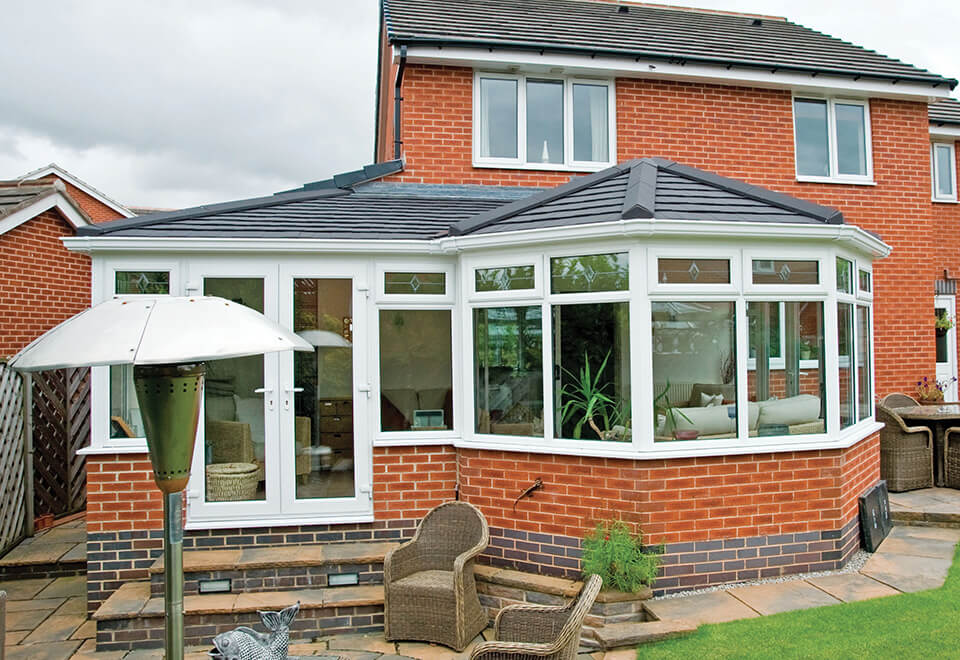 Bespoke conservatory with a grey tiled roof