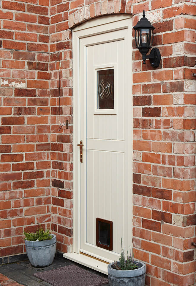Cream uPVC door with a cat flap