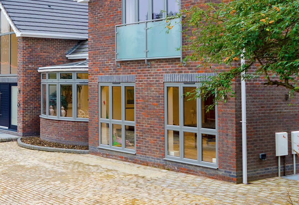 Grey aluminium casement windows