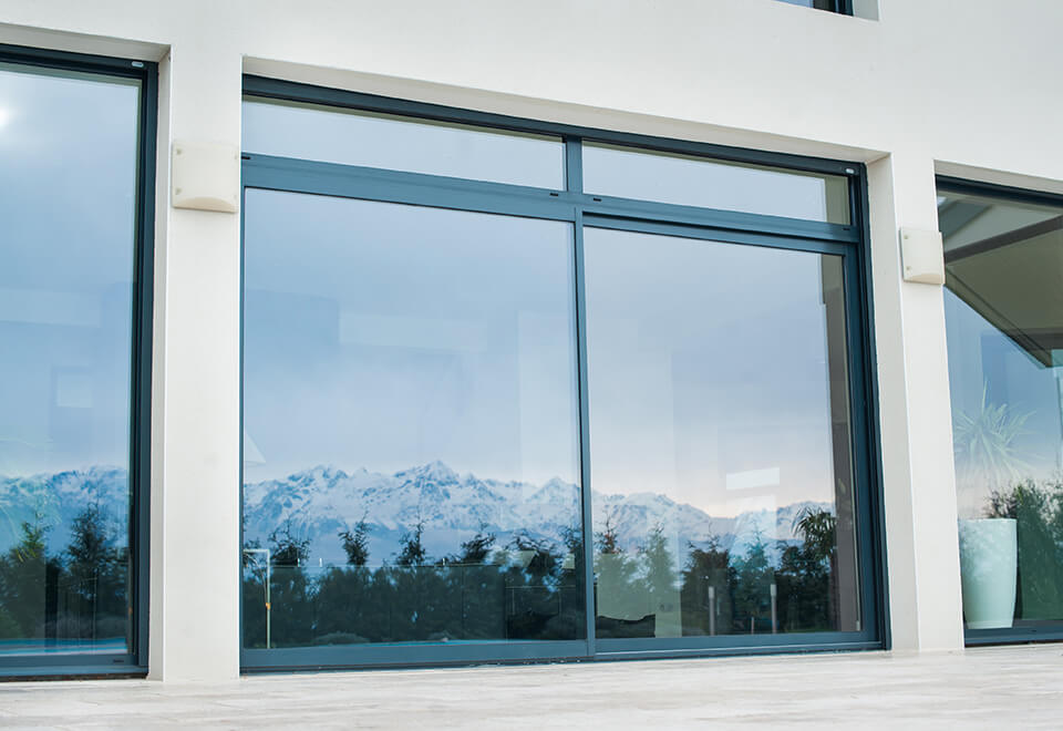 Grey sliding aluminium patio door