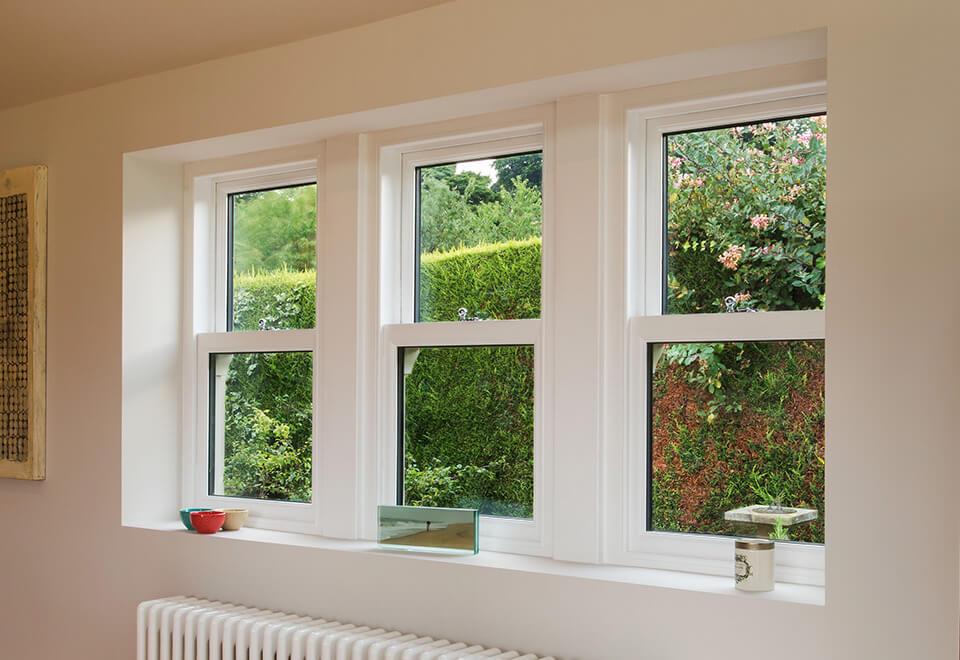 Interior view of white uPVC sliding sash windows
