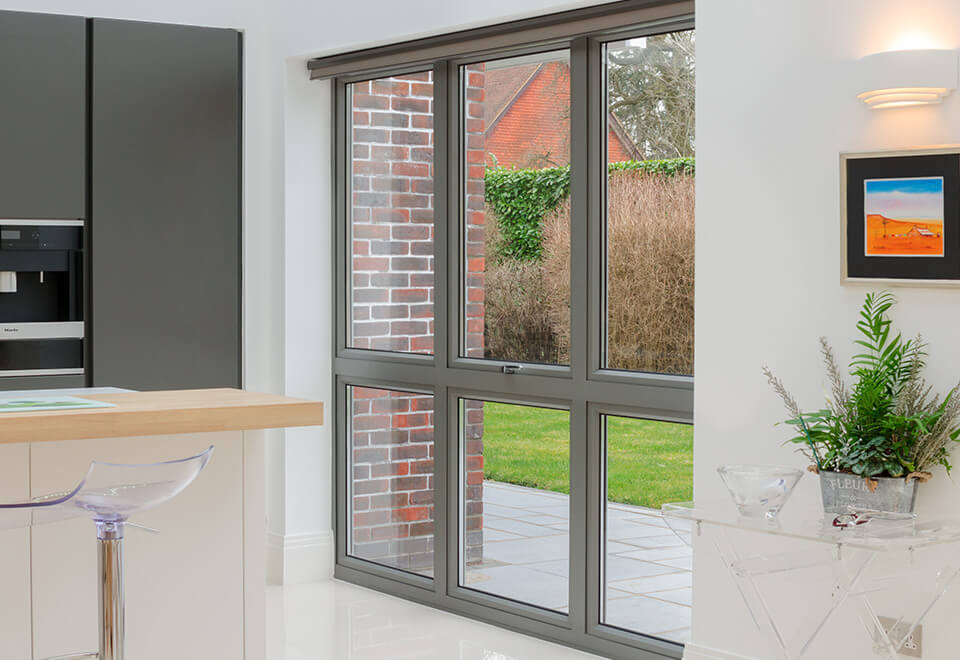 Large grey aluminium casement windows