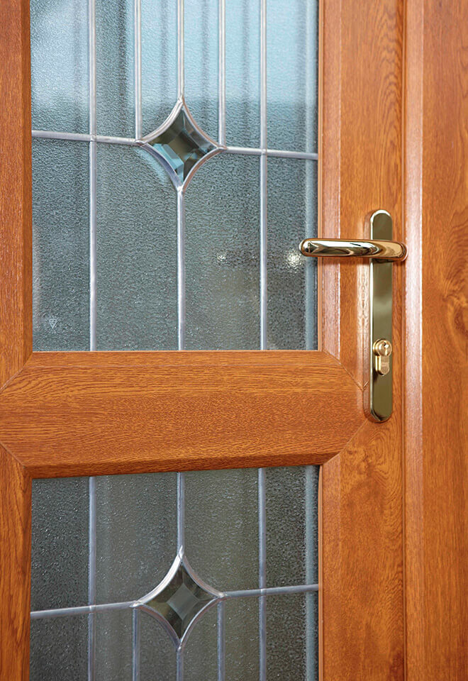 Golden oak effect uPVC entrance door close up