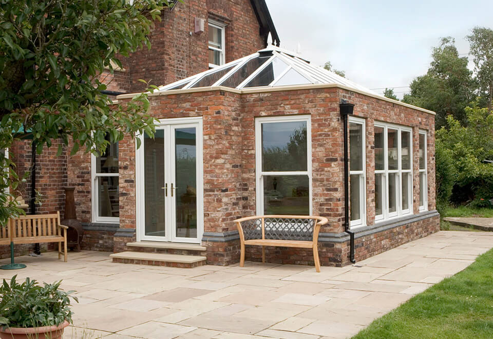 Red brick uPVC orangery installation