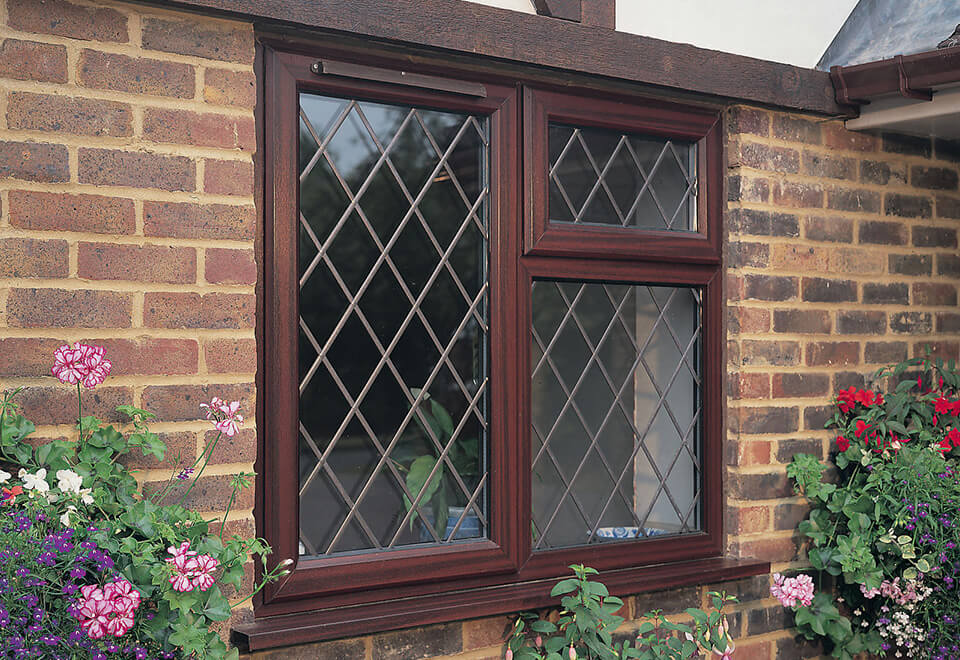 Rosewood uPVC casement window with leaded glass