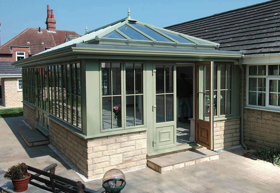 Sage green uPVC orangery installation