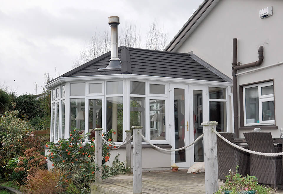 Tiled conservatory roof with a chimney