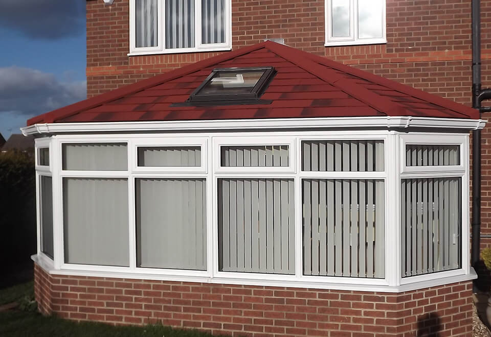 uPVC Victorian conservatory with a red tiled roof