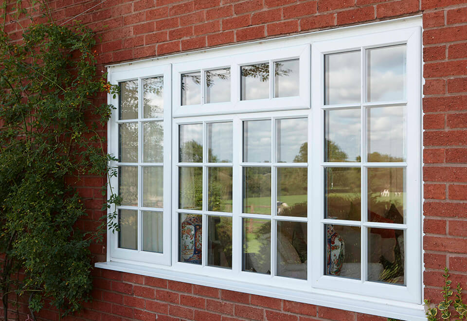 White uPVC casement window with astragal bars