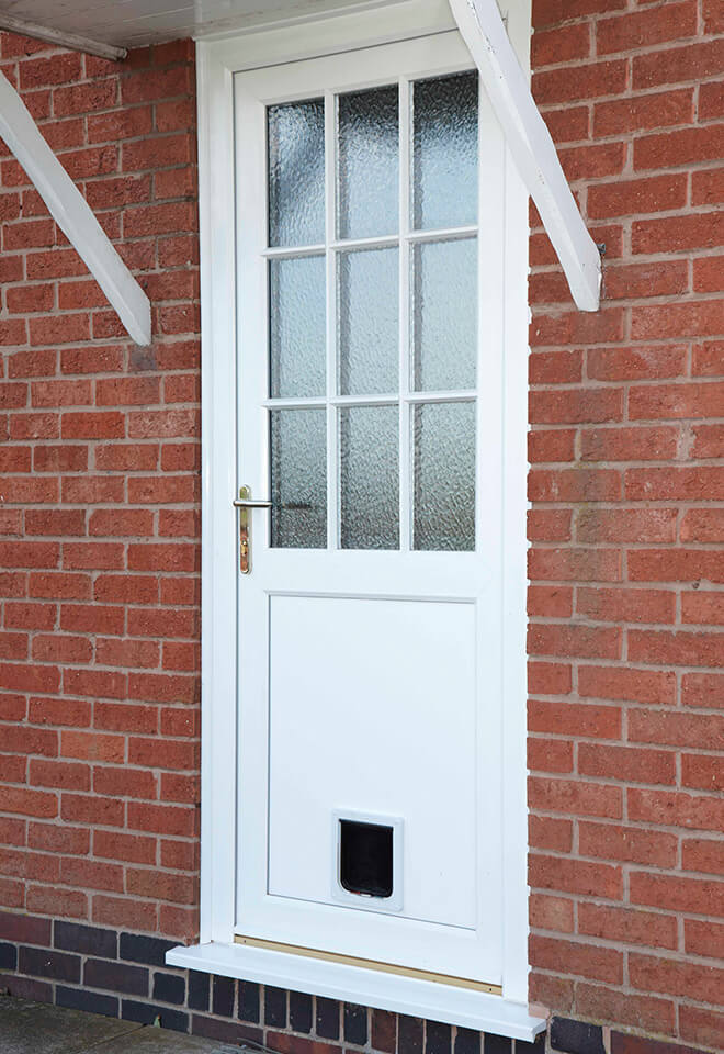 White uPVC door with a cat flap