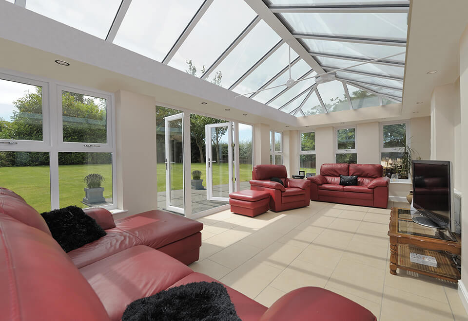 Large white uPVC orangery interior view