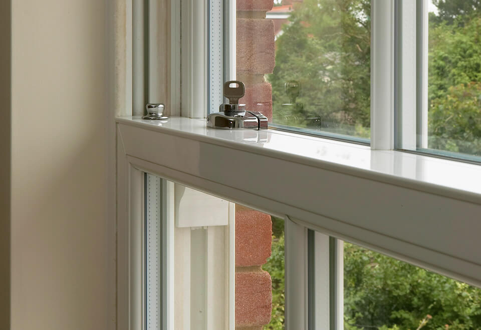 White uPVC sliding sash window close up
